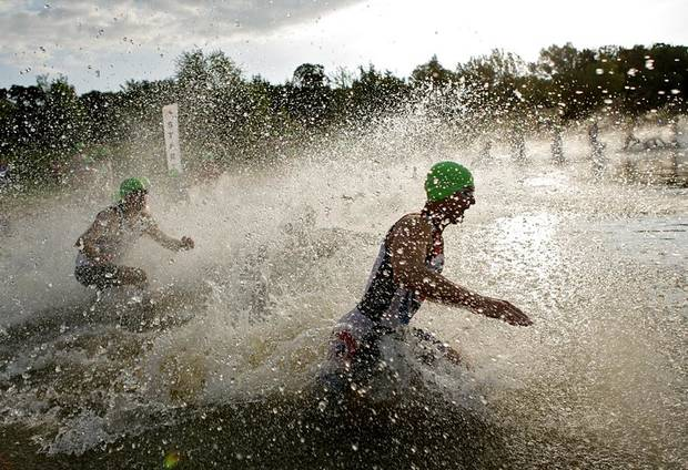 Athletes race into the water to start the Arcadia Lake Triathlon and Aqua-Bike at Arcadia Lake in Edmond, Oklahoma on Sunday, Aug. 14, 2011. Photo by John Clanton, The Oklahoman
