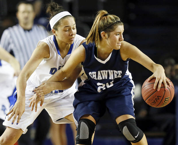 Shawnee's Bailey Taylor (20) spins away from Deer Creek's Ashley Gibson (33) during the Class 5A girls championship high school basketball game in the state tournament at the Mabee Center in Tulsa, Okla., Saturday, March 9, 2013. Photo by Nate Billings, The Oklahoman
