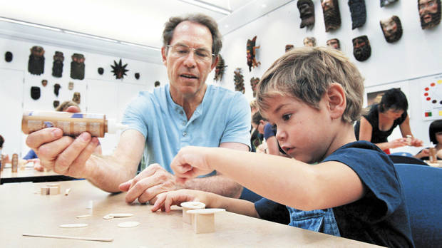 Paul Maenza and grandson Joseph Maenza work on their art project.