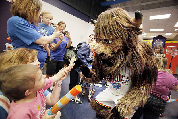 Oklahoma City Thunder mascot Rumble visits with patients at the J.D. McCarty Center on Thursday at a  �Thunder Appreciation Day� staged for the children. PHOTOs BY STEVE SISNEY, THE OKLAHOMAN