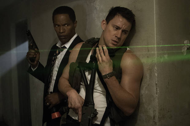 "This film publicity image released by Columbia Pictures shows Jamie Foxx, left, and Channing Tatum in a scene from ""White House Down."" (AP Photo/Sony Columbia Pictures, Reiner Bajo)"