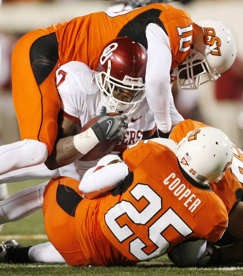 DeMarco Murray is brought down after an eleven-yard kick return during the first half of the college football game between the University of Oklahoma Sooners (OU) and Oklahoma State University Cowboys (OSU) at Boone Pickens Stadium on Saturday, Nov. 29, 2008, in Stillwater, Okla. STAFF PHOTO BY NATE BILLINGS