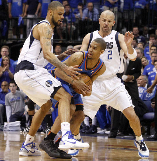 Oklahoma City's Eric Maynor (6) looks to pass from between Tyson Chandler (6) and Jason Kidd (2) of Dallas during game 2 of the Western Conference Finals in the NBA basketball playoffs between the Dallas Mavericks and the Oklahoma City Thunder at American Airlines Center in Dallas, Thursday, May 19, 2011. Photo by Bryan Terry, The Oklahoman