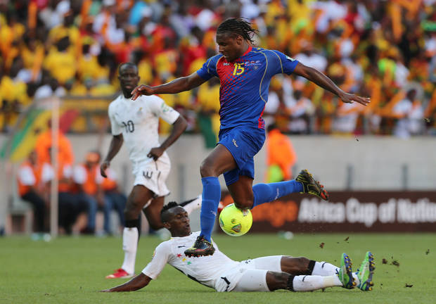 Cape Verde's Marco Soares, top, avoids a tackle from Ghana's Harrison Afful, bottom, during their quarter final of the African Cup of Nations  soccer match at the Nelson Mandela Bay Stadium in Port Elizabeth, South Africa, Saturday Feb. 2, 2013. (AP Photo/Themba Hadebe)