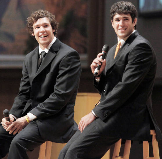 OU quarterback Sam Bradford, left, and OSU quarterback Zac Robinson were special guests at the Fellowship of Christian Athletes All-State Banquet on Monday. Photo by Nate Billings, The Oklahoman