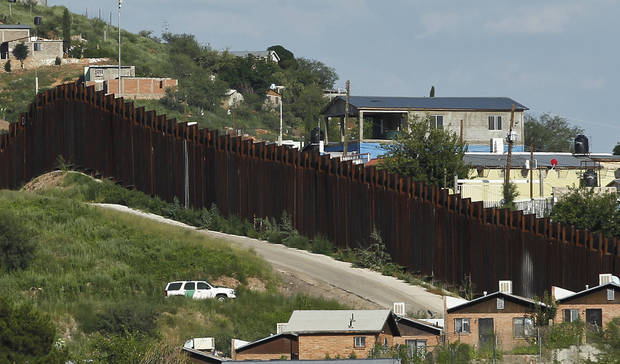 In this photo taken Thursday, Aug. 9, 2012, A U.S. Border Patrol vehicle keeps watch along the border fence in Nogales, Ariz. A U.S. Border Patrol agent opened fire on a group of people throwing rocks from across the Mexican border, killing a teenage boy and eliciting outrage from the Mexican government over the use of lethal force, authorities said Thursday.(AP Photo/Ross D. Franklin)