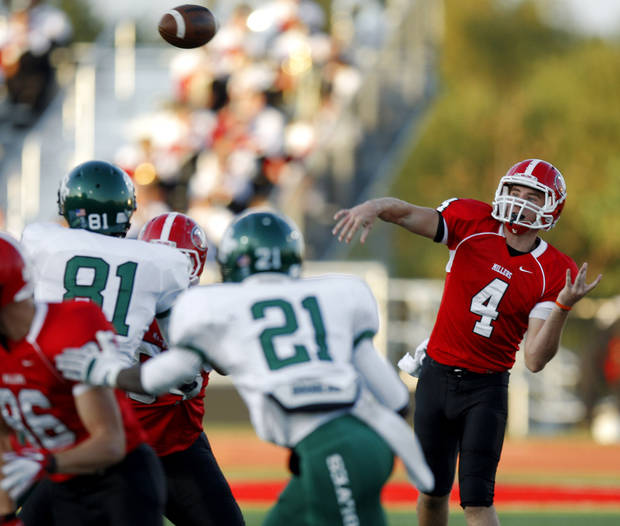Yukon's Corben Jones throws a pass against Edmond Santa Fe during a high school football game in Yukon, Okla., Friday, Sept. 9, 2011. Photo by Bryan Terry, The Oklahoman