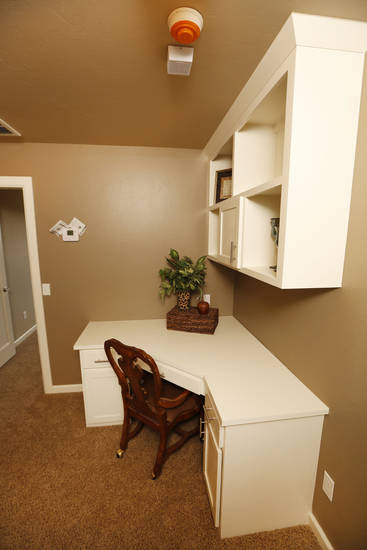 A desk and cabinets are built in to create a work or study area in an upstairs nook of a model home by TimberCraft Homes, 8440 NW 142, in the Pleasant Grove addition northwest of Kilpatrick Turnpile and N Council Road. Photo by Steve Gooch, The Oklahoman <strong>Steve Gooch</strong>