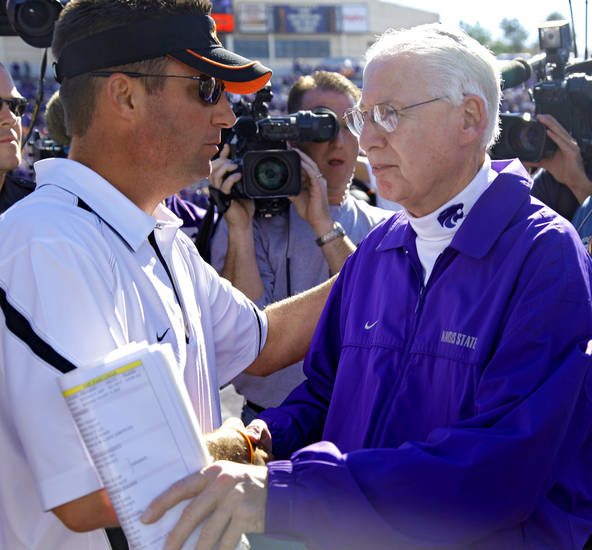Oklahoma State coach Mike Gundy shakes hands with Kansas State coach Bill Snyder after the Cowboys 24-14 win over the Wildcats in the college football game between the Oklahoma State University Cowboys (OSU) and the Kansas State University Wildcats (KSU) on Saturday, Oct. 30, 2010, in Manhattan, Kan.   Photo by Chris Landsberger, The Oklahoman