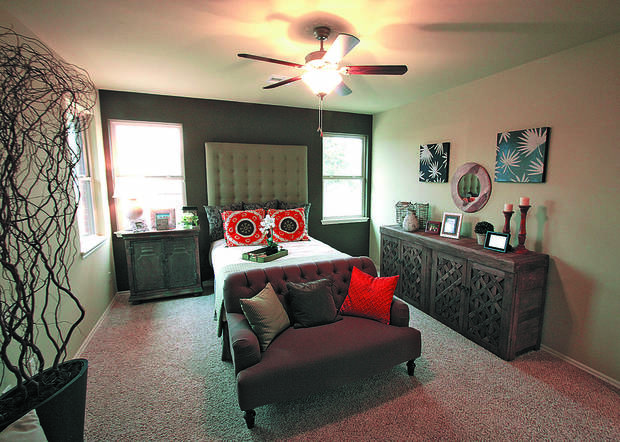 It's a bungalow, but the McCaleb Homes model at Arbor Creek has a master bedroom with room for sitting space. <strong>David McDaniel - The Oklahoman</strong>