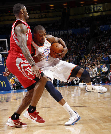 Oklahoma City's Kevin Durant (35) tries to keep control of the ball as Terrence Williams (1) of Houston defends in the first half during the NBA basketball game between the Oklahoma City Thunder and the Houston Rockets at Chesapeake Energy Arena in Oklahoma City, Friday, Jan. 6, 2012. Photo by Nate Billings, The Oklahoman