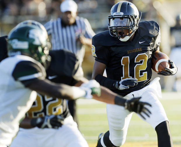 Midwest City's Cornell Neal (12) looks for running room during the high school football game between Midwest City and Edmond Santa Fe at Rose Field in Midwest City, Okla., Thursday, Aug. 30, 2012. Photo by Nate Billings, The Oklahoman
