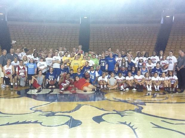 The All-Staters and Special Olympians took a moment to pose together for a team photo.