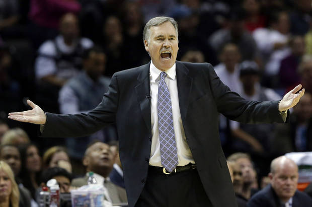 Los Angeles Lakers coach Mike D'Antoni reacts during the second quarter of an NBA basketball game against the San Antonio Spurs, Wednesday, Jan. 9, 2013, in San Antonio. (AP Photo/Eric Gay)
