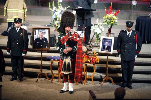 Robert Bruce plays the bagpipes during the funeral of Nichols Hills Fire Chief Keith Bryan on Saturday at The Bridge Assembly of God in Mustang. <strong>PAUL HELLSTERN</strong>