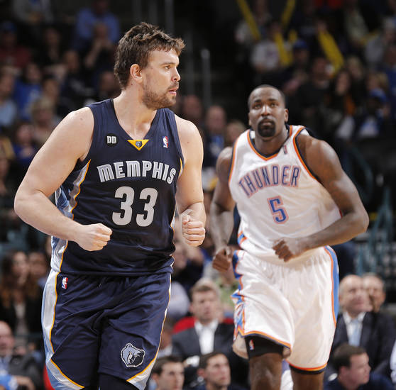 Memphis' Marc Gasol (33) reacts in front of Oklahoma City's Kendrick Perkins (5) after hitting a shot in the fourth quarter during the NBA basketball game between the Oklahoma City Thunder and the Memphis Grizzlies at Chesapeake Energy Arena on Wednesday, Nov. 14, 2012, in Oklahoma City, Okla.   Photo by Chris Landsberger, The Oklahoman