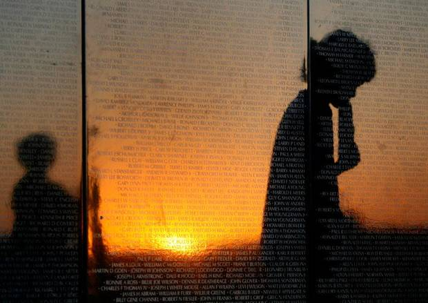 A person is reflected in the Dignity Memorial Vietnam Wall as it is assembled at Piedmont High School on Wednesday, July 1, 2009. Photo by Bryan Terry, The Oklahoman