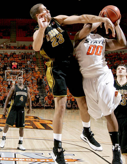 Missouri's Justin Saford defends OSU's Obi Byron Eaton during the Big 12 college basketball game between Oklahoma State and Missouri at Gallagher-Iba Arena in Stillwater, Okla., Wednesday, Jan. 21, 2009.  PHOTO BY BRYAN TERRY, THE OKLAHOMAN