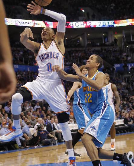 Oklahoma City Thunder&#039;s Russell Westbrook (0) is fouled by New Orleans Hornets&#039; Brian Roberts (22) during the NBA basketball game between the Oklahoma City Thunder and the New Orleans Hornets at the Chesapeake Energy Arena on Wednesday, Feb. 27, 2013, in Oklahoma City, Okla. Photo by Chris Landsberger, The Oklahoman