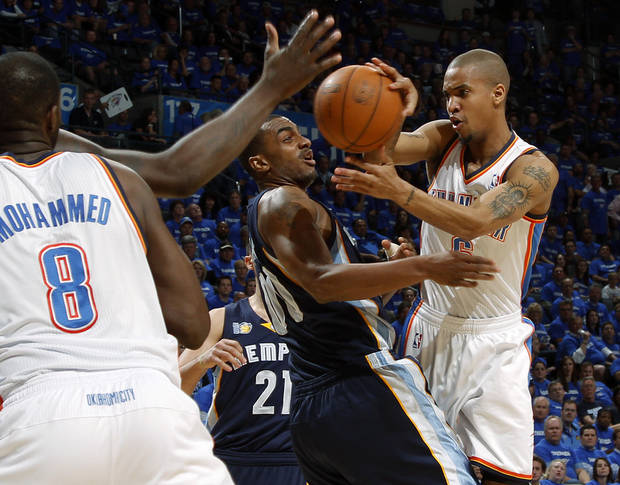 Oklahoma City's Eric Maynor (6) passes the ball around Darrell Arthur (00) of Memphis during game two of the Western Conference semifinals between the Memphis Grizzlies and the Oklahoma City Thunder in the NBA basketball playoffs at Oklahoma City Arena in Oklahoma City, Tuesday, May 3, 2011. Photo by Bryan Terry, The Oklahoman