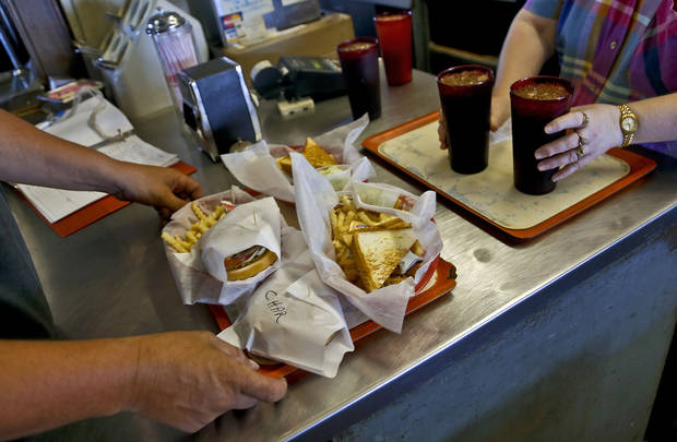 Lunch orders are picked up in the final week of business at Ballard's Drive-In  in Pauls Valley. <strong>CHRIS LANDSBERGER - THE OKLAHOMAN</strong>