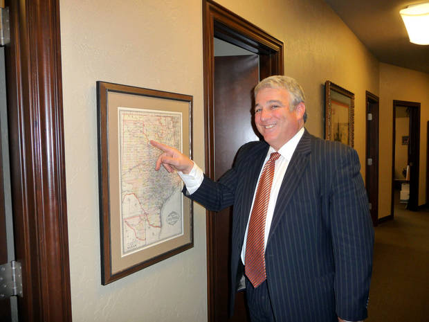 Edmond Attorney Andy Lester points out details in an early 1890s map of Indian Territory that did not incorporate much of what was known as Greer County. PHOTOs BY KEVAN GOFF-PARKER, For The Oklahoman