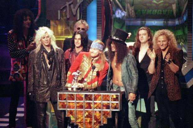 Guns N&#039;Roses rock group receives the Michael Jackson Video Vanguard Award for &quot;November Rain&quot; at the MTV Video Music Awards ceremony in Los Angeles, Ca., on Sept. 9, 1992. At the podium are, Axl Rose, left, and Slash. Joining them on the stage are, from left, Duff McKagan, Gilby Clarke, Dizzy Reed and Matt Sorum. (AP Photo/Kevork Djansezian) &lt;strong&gt;&lt;/strong&gt;