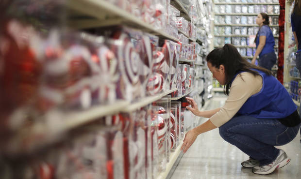 Hobby Lobby employee Heidi Cranor stocks the shelves with Christmas merchandise at Hobby Lobby, 3160 S Broadway in Edmond.