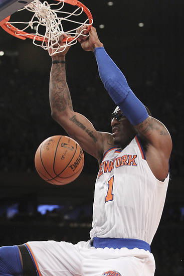 New York Knicks' Amare Stoudemire dunks during the first half of NBA basketball game against the Sacramento Kings, Saturday, Feb. 2, 2013, at Madison Square Garden in New York. (AP Photo/Mary Altaffer)
