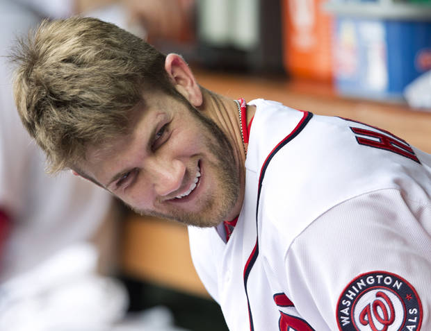 Washington Nationals Bryce Harper smiles as he sits in the dugout during a baseball game against the Philadelphia Phillies in Washington, Wednesday, Oct. 3, 2012. The Nationals won 5-1. (AP Photo/Manuel Balce Ceneta)
