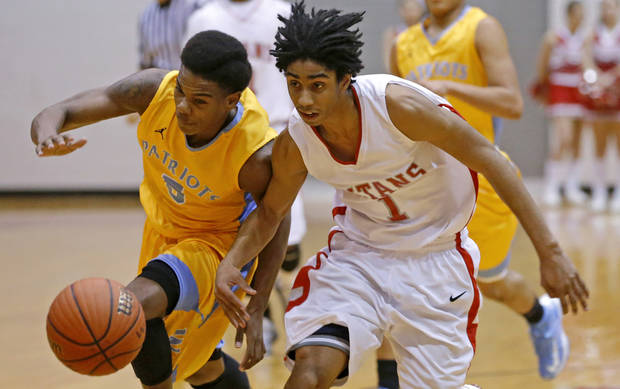 Carl Albert's Malik Barnett, right, and Putnam CIty West's Omega Harris go for the ball during their high school basketball game at Carl Albert in Midwest City, Okla., Friday, Jan. 25, 2013. Photo by Bryan Terry, The Oklahoman