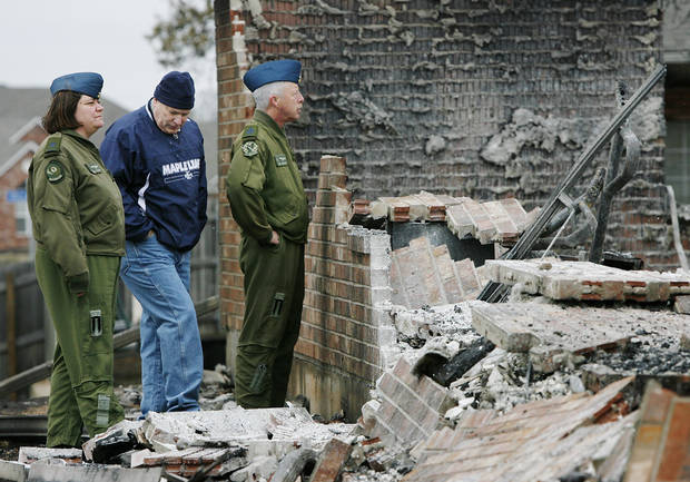 Roger Burgwyn, center and two fellow members of the Canadian Air Force  look at the remains of his home  Friday morning, April 10, 2009 which was destroyed in Thursday's wildfires.  At right is CWO James Dawson.  Photo by Jim Beckel, The Oklahoman