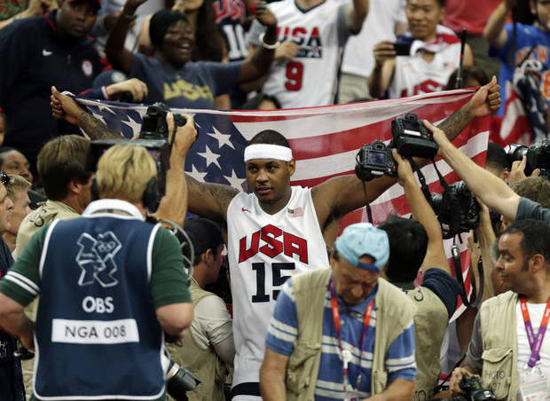 United States' Carmelo Anthony celebrates after the men's gold medal basketball game at the 2012 Summer Olympics, Sunday, Aug. 12, 2012, in London. USA won 107-100. (AP Photo/Charles Krupa)