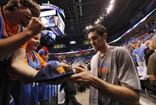 Oklahoma City's Nick Collison signs autographs for fans before the start of Game 2 in the second round of the NBA playoffs between the Oklahoma City Thunder and the L.A. Lakers at Chesapeake Energy Arena on Wednesday,  May 16, 2012, in Oklahoma City, Oklahoma. Photo by Chris Landsberger, The Oklahoman