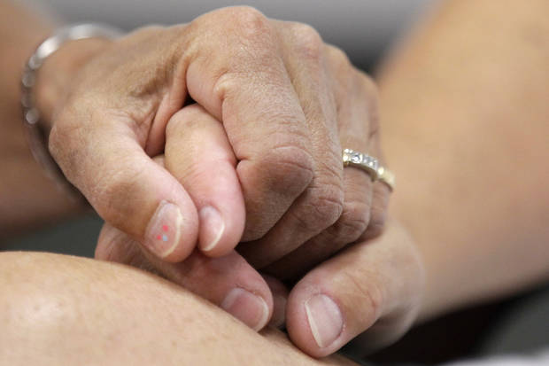 Ellen Toplin and Charlene Kurland hold hands as they obtain a marriage license at a Montgomery County office despite a state law banning such unions, Wednesday, July 24, 2013, in Norristown, Pa. (AP Photo/Matt Rourke)