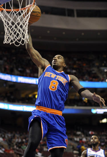 New York Knicks' J.R. Smith (8) dunks the ball during the first half of an NBA basketball game against the Philadelphia 76ers on Monday, Nov. 5, 2012, in Philadelphia. (AP Photo/Michael Perez)