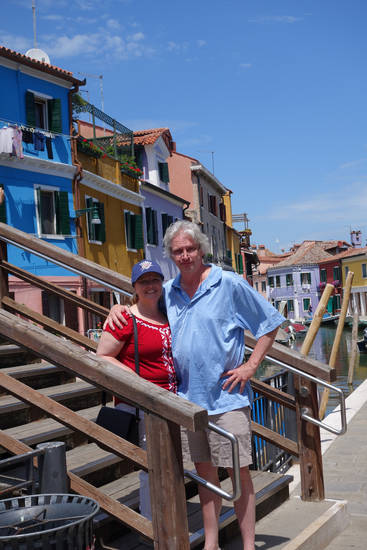 Tricia and Berry Tramel stand by the canal that runs through Burano, Italy. (Photo provided)