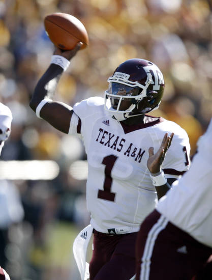 Texas A&M quarterback Jerrod Johnson (1) throws against Colorado during the first quarter of an NCAA college football game in Boulder, Colo, Saturday, Nov. 7, 2009. (AP Photo/Jack Dempsey) ORG XMIT: COJD101
