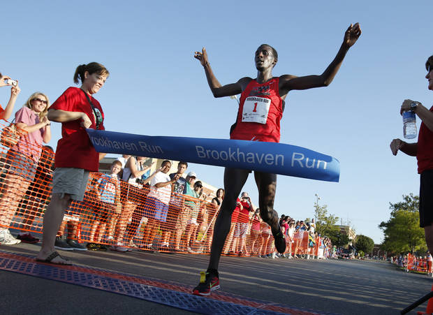 Silas Kisorio finishes the 5K run with a time of 14:41 and in first place at the annual Brookhaven Run on Saturday, Sept. 1, 2012 in Norman, Okla.  Photo by Steve Sisney, The Oklahoman