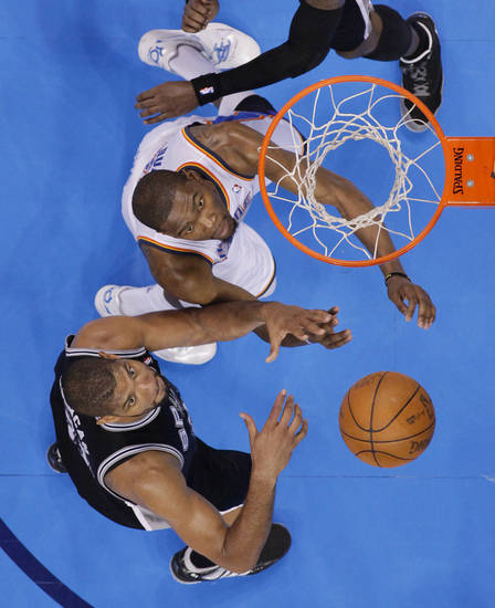 Oklahoma City's Kevin Durant (35) and San Antonio's Tim Duncan (21) work under the basket during Game 6 of the Western Conference Finals between the Oklahoma City Thunder and the San Antonio Spurs in the NBA playoffs at the Chesapeake Energy Arena in Oklahoma City, Wednesday, June 6, 2012. Photo by Chris Landsberger, The Oklahoman
