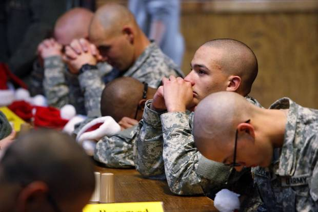 New recruits pray before lunch at Gatti Town during Soldiers Day Out, Friday, December 21, 2012. Edmond/North OKC Blue Star Mothers will be taking the soldiers who can't go home for Christmas around the metro for a day of fun. Photo By David McDaniel/The Oklahoman