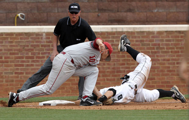 Oklahoma's Garrett Carey (10) tags out Army's Alex Jensen (8) at third base during an NCAA college baseball regional game in Charlottesville, Va., Sunday, June 3, 2012. Oklahoma defeated Army 2-1. (AP Photo/Andrew Shurtleff) ORG XMIT: VAAS108