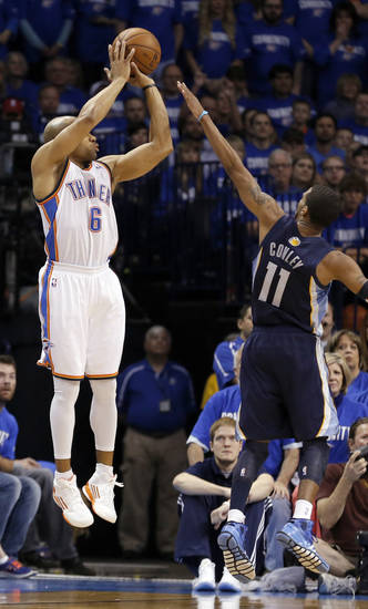 Oklahoma City's Derek Fisher (6) shoots a three pointer over Memphis' Mike Conley (11)  during Game 1 in the second round of the NBA playoffs between the Oklahoma City Thunder and the Memphis Grizzlies at Chesapeake Energy Arena in Oklahoma City, Sunday, May 5, 2013. Photo by Sarah Phipps, The Oklahoman