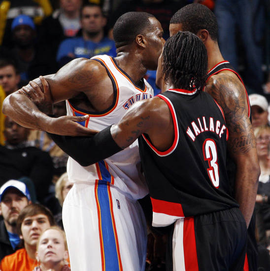 Portland's Gerald Wallace (3) tries to separate teammate LaMarcus Aldridge (12) and Oklahoma City's Kendrick Perkins (5) late in the fourth quarter during the NBA basketball game between the Oklahoma City Thunder and Portland Trail Blazers at Chesapeake Energy Arena in Oklahoma City, Tuesday, Jan. 3, 2012. Perkins and Aldridge were each given technical fouls. Portland won, 103-93. Photo by Nate Billings, The Oklahoman