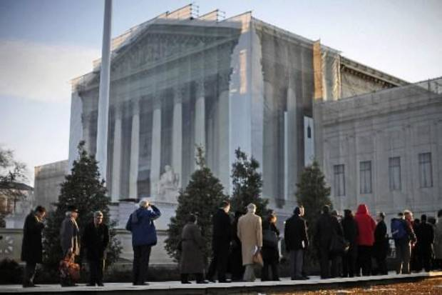 People line up for entrance into the Supreme Court in Washington, Tuesday, March 26, 2013, where the court will hear arguments on California�s voter approved ban on same-sex marriage, Proposition 8. (AP Photo/Pablo Martinez Monsivais)