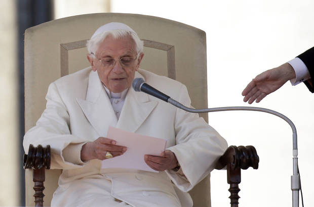 Pope Benedict XVI reads a message during his final general audience in St. Peter&#039;s Square at the Vatican, Wednesday, Feb. 27, 2013. Pope Benedict XVI basked in an emotional sendoff Wednesday at his final general audience in St. Peter&#039;s Square, recalling moments of &quot;joy and light&quot; during his papacy but also times of great difficulty. He also thanked his flock for respecting his decision to retire. (AP Photo/Gregorio Borgia) ORG XMIT: VAT193