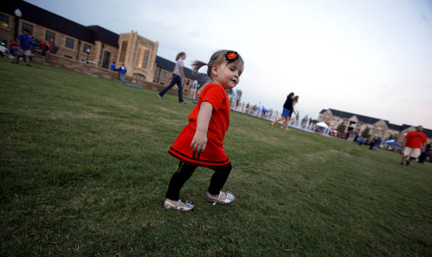 Vivian Farr, 1, plays before Oklahoma State's game at Tulsa on Saturday. Photo by Sarah Phipps, The Oklahoman