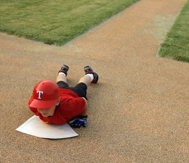 Gage Hietpas, 7, of Yukon, Okla., slides home during a game in the Yukon Spirit League at Taylor Park in Yukon, Okla., Tuesday, September 1,  2009. The Spirit League is a T-ball league for special-needs children and adults. By Nate Billings, The Oklahoman