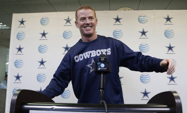 Dallas Cowboys coach Jason Garrett arrives to speak to reporters during an availability at the NFL football team's facility Wednesday, Feb. 13, 2013, in Irving, Texas. (AP Photo/LM Otero)