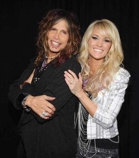 "Steven Tyler and Checotah native Carrie Underwood pose before their ""CMT Crossroads"" performance. (CMT photo)"